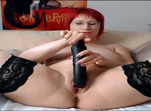 Awning Redhead Milf Fucks Broad in the beam Dildo